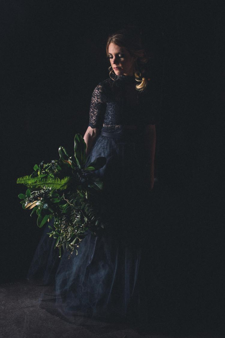 Dark Moody Black Dress Bride Large Wild Green Bouquet | Edgy Emerald City Wedding Ideas http://www.yvonnegollphotography.com/