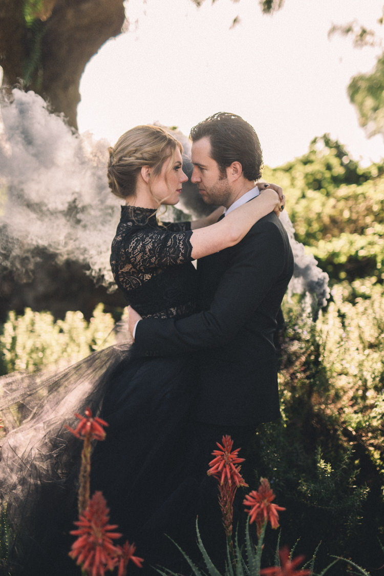 Dark Moody Black Dress Bride Groom Outdoor Smoke Photo Flowers | Edgy Emerald City Wedding Ideas http://www.yvonnegollphotography.com/