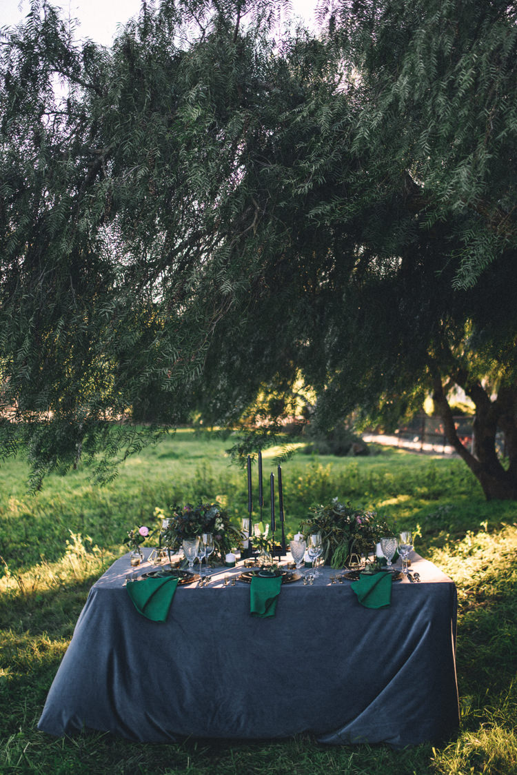 Dark Moody Black Green Gold Table Decor Candle Linen Trees Outdoor | Edgy Emerald City Wedding Ideas http://www.yvonnegollphotography.com/