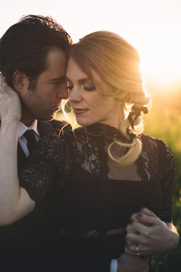 Dark Moody Black Dress Gold Sun Field Outdoor Kiss Bride Braid | Edgy Emerald City Wedding Ideas http://www.yvonnegollphotography.com/