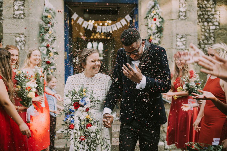 Bride Bridal Self Portrait Wedding Dress Long Sleeved High Neck Multicolour Trailing Bouquet Ribbon Plait Up Do Moss Bros Groom Velvet Tuxedo Jacket Just Married Confetti Garland Just Married Bunting Stylish Budget Friendly Village Hall Wedding http://natalyjphotography.com/