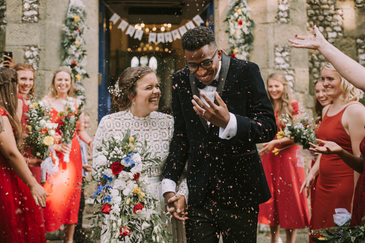 Bride Bridal Self Portrait Wedding Dress Long Sleeved High Neck Multicolour Trailing Bouquet Ribbon Plait Up Do Moss Bros Groom Velvet Tuxedo Jacket Just Married Confetti Garland Just Married Bunting Red Mismatched Bridesmaids Stylish Budget Friendly Village Hall Wedding http://natalyjphotography.com/