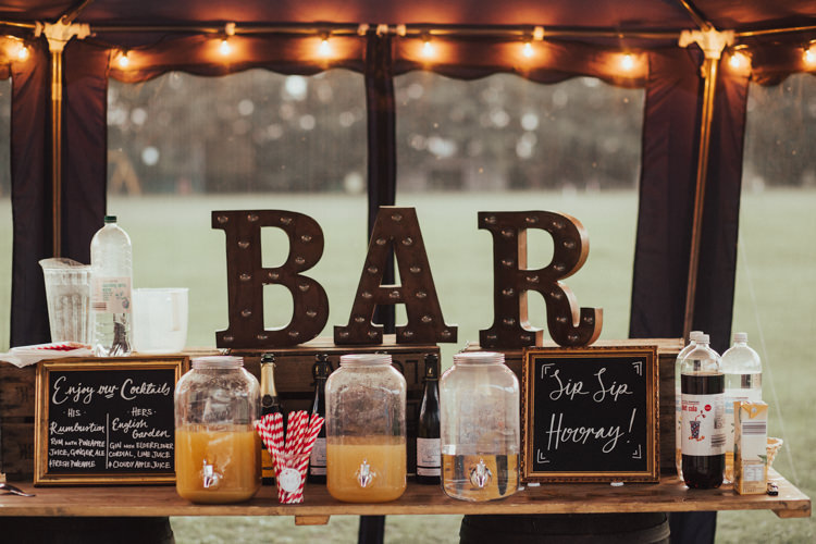Bar Vintage Rustic Light Up Circus Lights Black Board Gold Frame Kilner Drinks Dispensers Fairy Lights Stylish Budget Friendly Village Hall Wedding http://natalyjphotography.com/