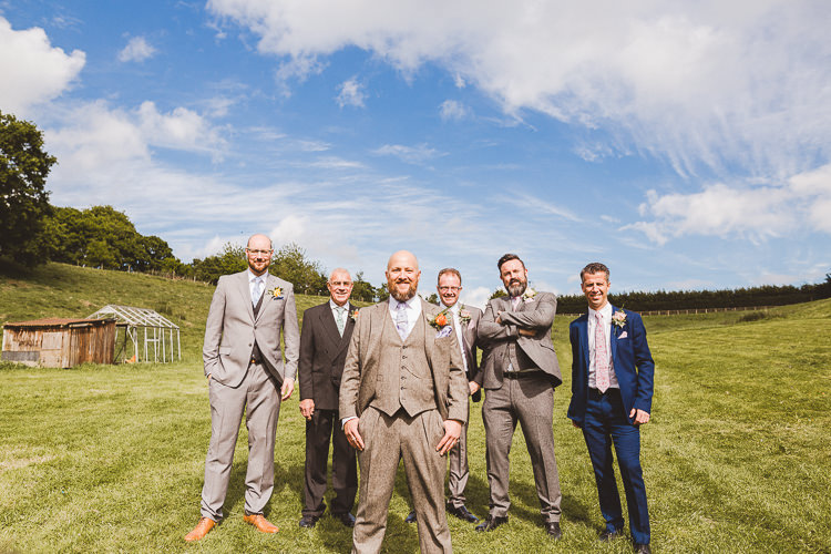 Brown Wool Suit Groom Brightly Coloured Mismatched Marquee Wedding http://www.nicolacasey.photography/