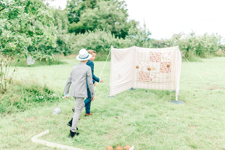 Coconut Shy Game Rustic Summer Country DIY Barn Wedding http://sarahjaneethan.co.uk/