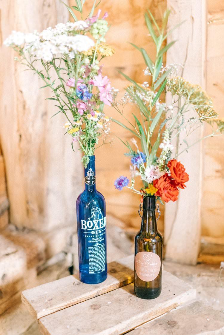 Bottle Gin Beer Flowers Decor Rustic Summer Country DIY Barn Wedding http://sarahjaneethan.co.uk/