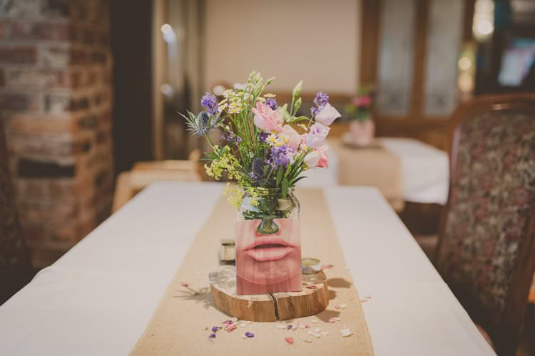 Centrepiece Decor Table Jar Flowers Log Slice Hessian Burlap Quirky Afternoon Tea Wedding http://laurarhianphotography.co.uk/