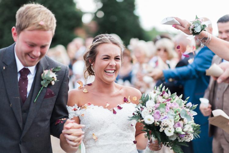 Bride Bridal Bardot Dress Gown Confetti Shot Grey Suit Groom Darling Hand Made Tipi Garden Wedding https://www.gemmagiorgio.com/