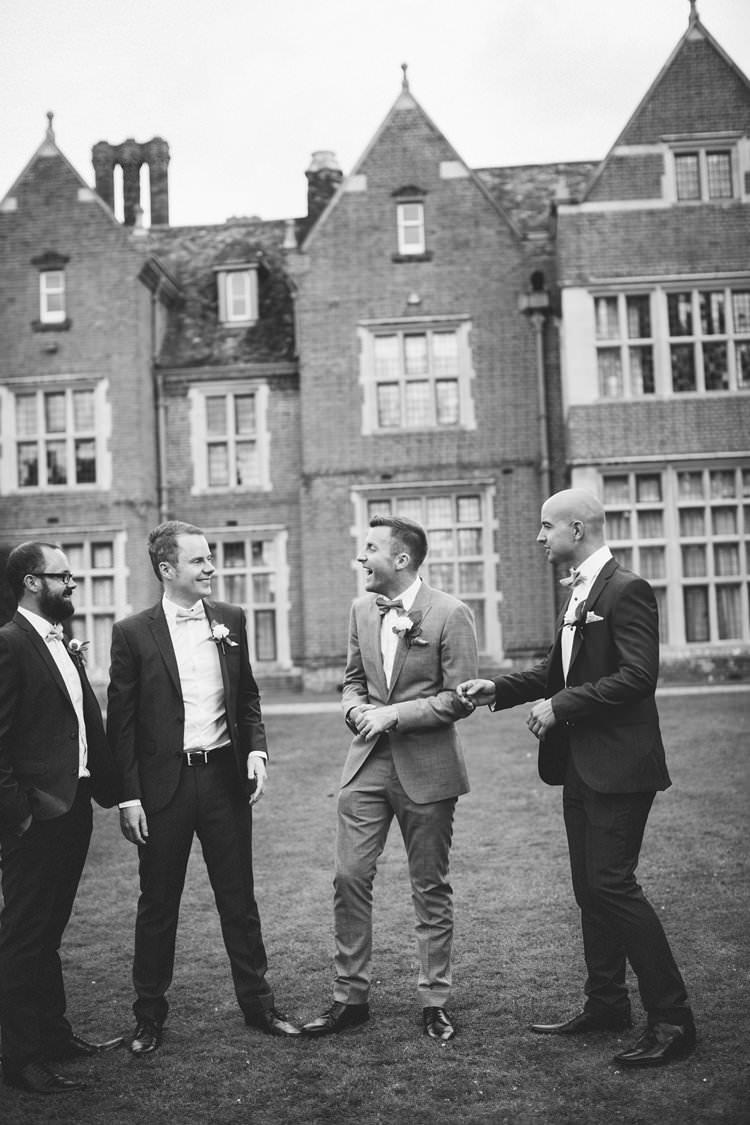 Groom Groomsmen Suits Bow Ties Pretty Floral Pastels Summer Wedding https://www.binkynixon.com/