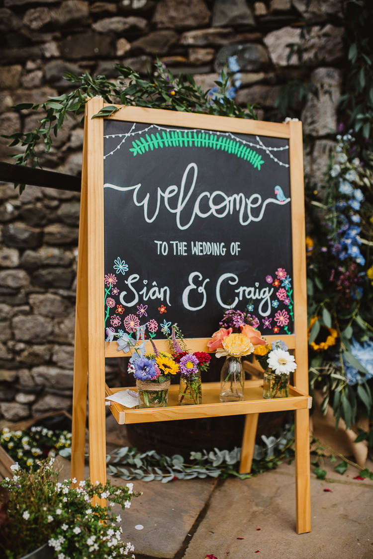 Welcome Sign Calligraphy Black Chalk Board Easel Colourful DIY Floral Luxe Barn Wedding http://www.joemather-photography.co.uk/