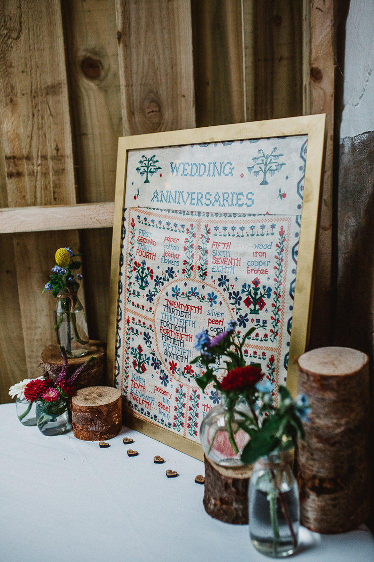 Embriodery Sign Cross Stitch Colourful DIY Floral Luxe Barn Wedding http://www.joemather-photography.co.uk/