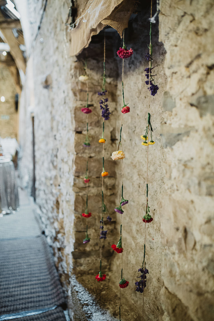 Hanging Flowers Wall Colourful DIY Floral Luxe Barn Wedding http://www.joemather-photography.co.uk/