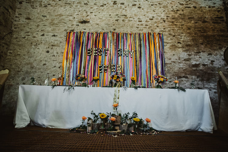Ribbon Backdrop Top Table Decor Colourful DIY Floral Luxe Barn Wedding http://www.joemather-photography.co.uk/