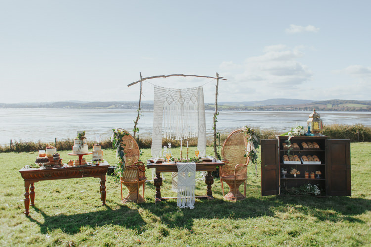Peacock Chairs Macrame Backdrop Pampas Grass Greenery Tablescape Decor Bohemian Luxe Coastal Wedding Ideas https://www.tarastattonphotography.com/