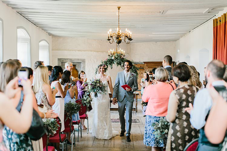 Destination Ceremony Bride Groom Aisle Wild Natural Bouquet Chandeliers Floral Arch | Romantic Castle Switzerland Wedding http://kbalzerphotography.com/