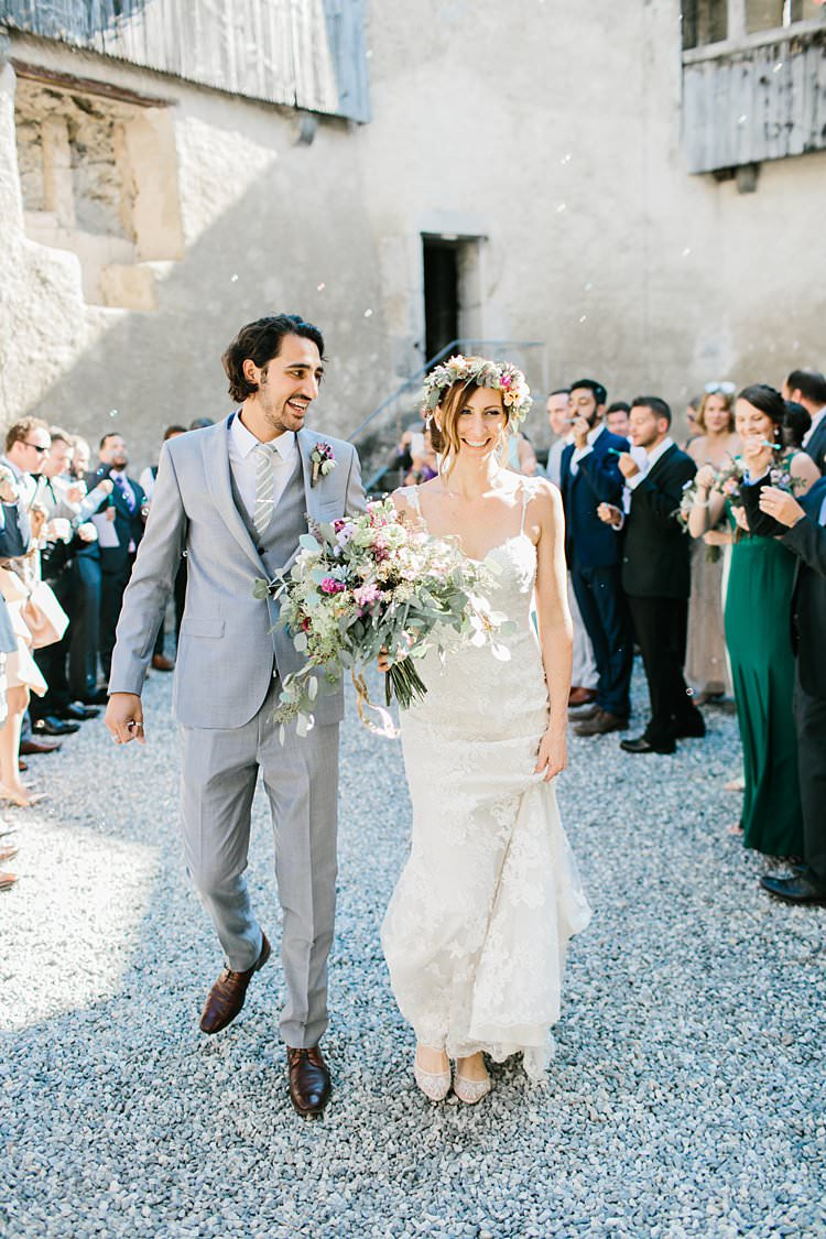 Destination Summer Mountains Confetti Relaxed Sweetheart Dress Grey Suit Bride Groom | Romantic Castle Switzerland Wedding http://kbalzerphotography.com/