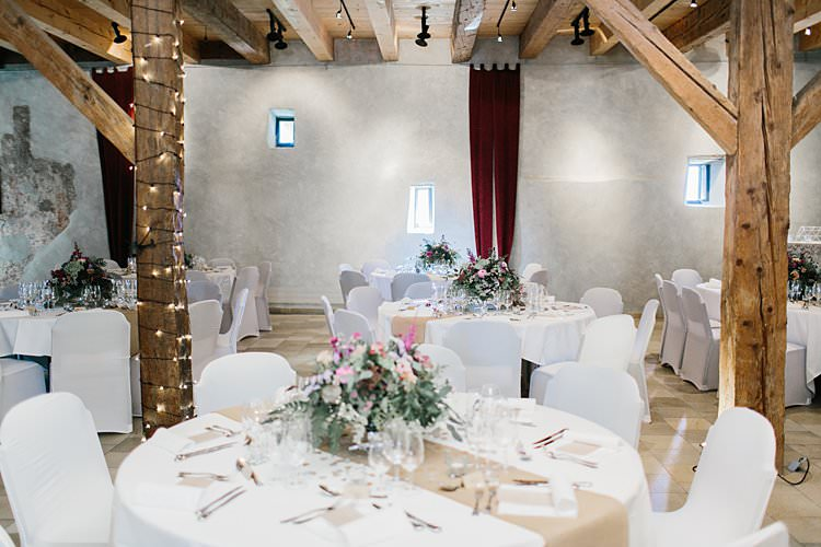 Destination Wooden Beams Fairy Lights White Brown Tablescapes Floral Centrepieces Rustic | Romantic Castle Switzerland Wedding http://kbalzerphotography.com/