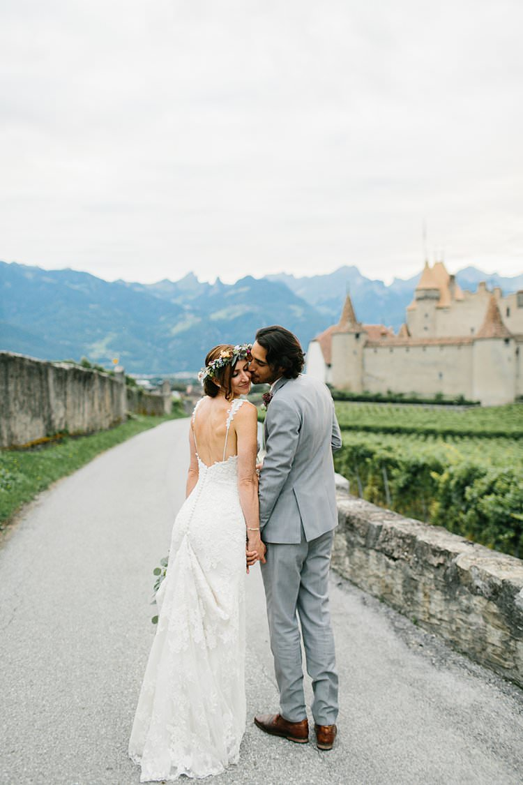 Beautiful Destination Mountains Summer Vineyards Fields Bride Groom Kiss | Romantic Castle Switzerland Wedding http://kbalzerphotography.com/