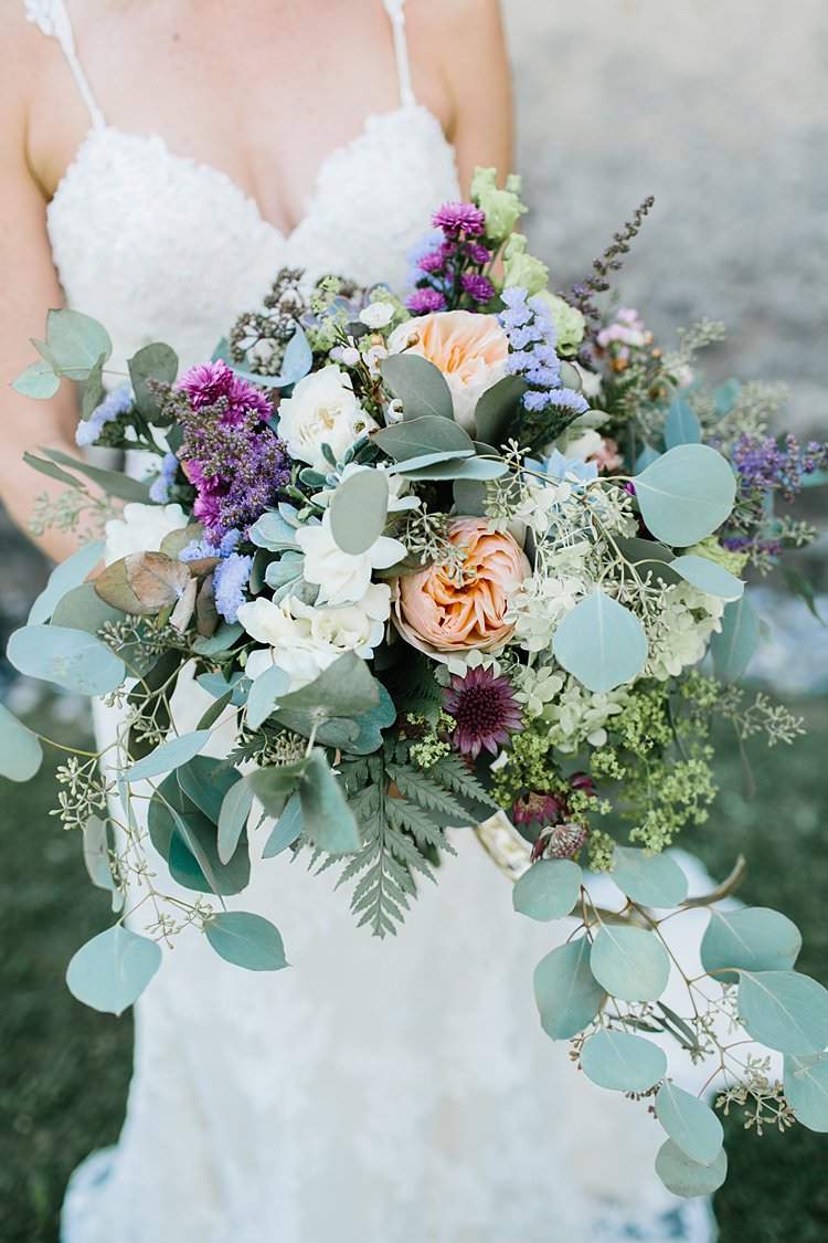 Wild Natural Bouquet Green Lilac Purple Peach Berry Sweetheart Dress Bride | Romantic Castle Switzerland Wedding http://kbalzerphotography.com/