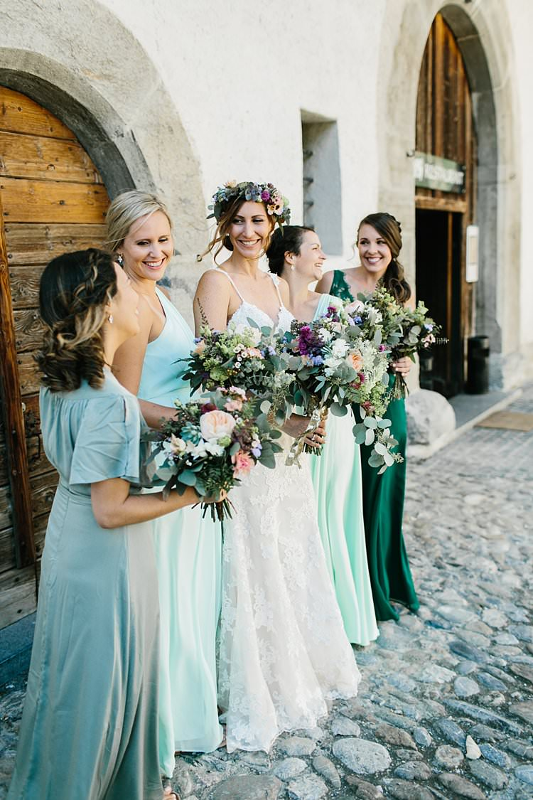 Destination Bride Bridesmaids Bouquets Green Gowns Smile Bridal Party Photo | Romantic Castle Switzerland Wedding http://kbalzerphotography.com/