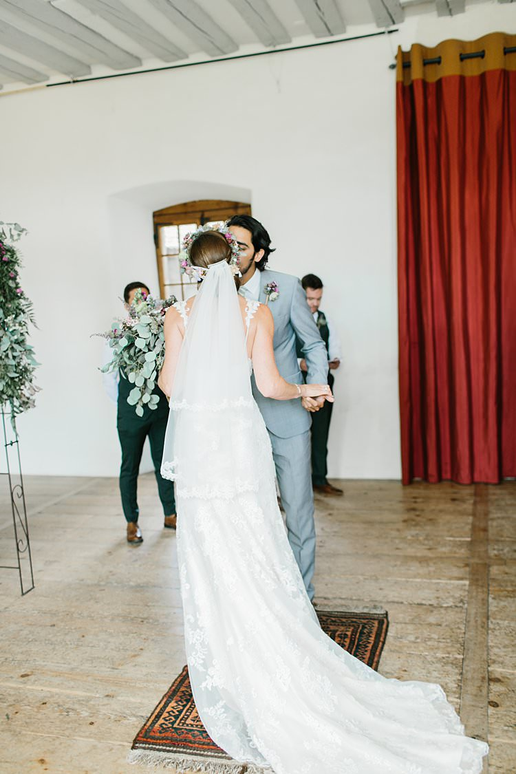 Destination Ceremony Bride Short Veil Groom Kiss Wild Natural Bouquet Rug | Romantic Castle Switzerland Wedding http://kbalzerphotography.com/