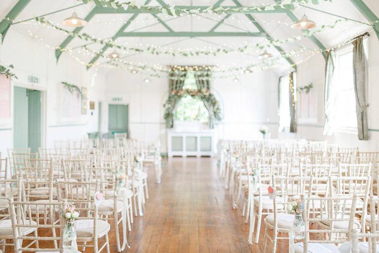 Fairy Lights Paper Leaf Garlands Ceremony Room Light Airy Pretty Pastel Pink Wedding http://whitestagweddings.com/