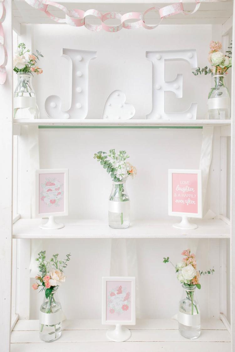 Dresser Furniture Decor Flowers Bottles Light Airy Pretty Pastel Pink Wedding http://whitestagweddings.com/