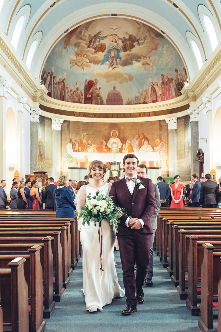 Bride Groom Ceremony Walk Down Aisle Recessional Bouquet Church Dome | Greenery Burgundy City Autumn Wedding http://lisahowardphotography.co.uk/