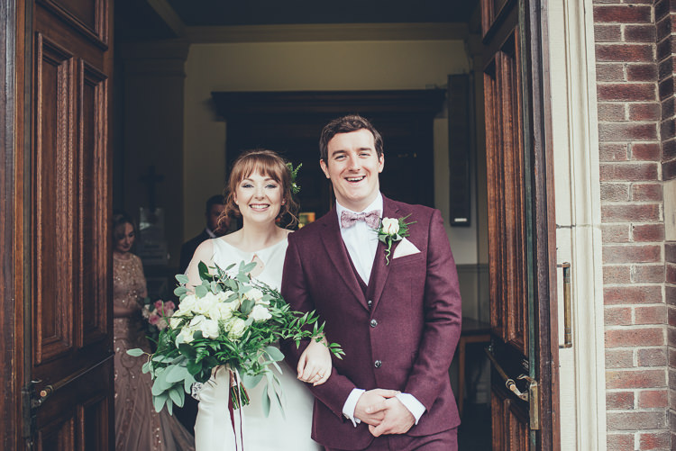 Bride Groom After Ceremony Church Bright Happy Airy Foliage Bouquet | Greenery Burgundy City Autumn Wedding http://lisahowardphotography.co.uk/