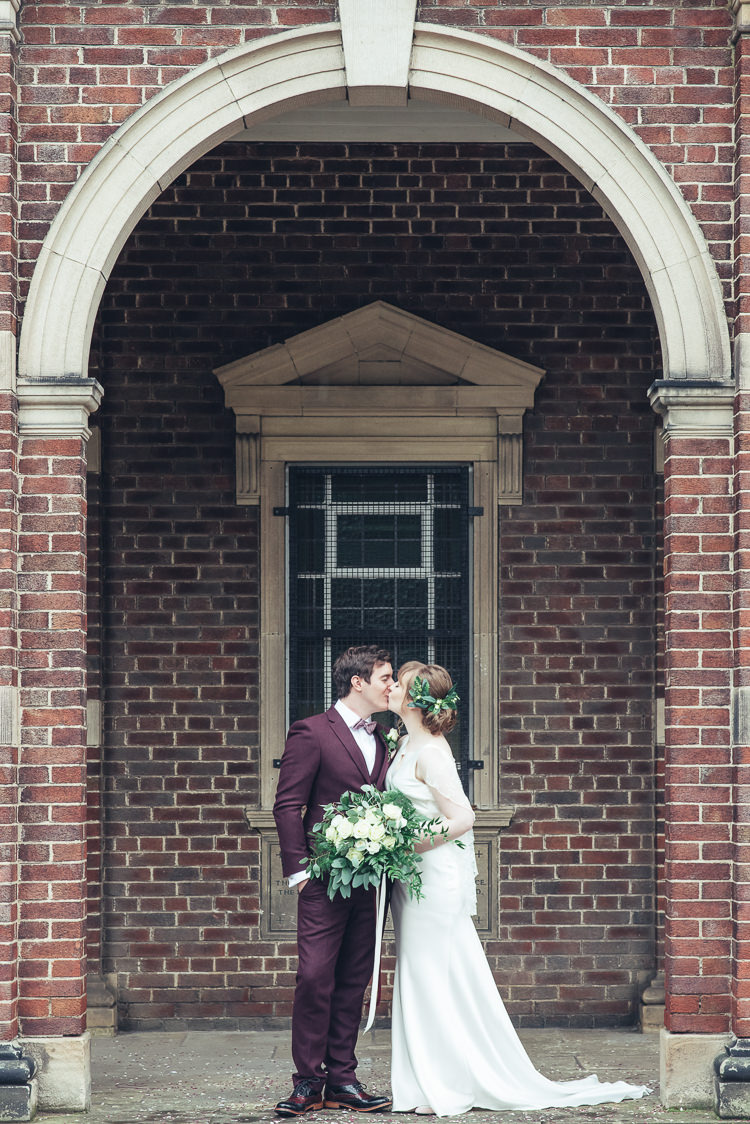 Bride Groom Kiss After Ceremony Romantic Industrial Brick Building Wild Foliage Bouquet | Greenery Burgundy City Autumn Wedding http://lisahowardphotography.co.uk/
