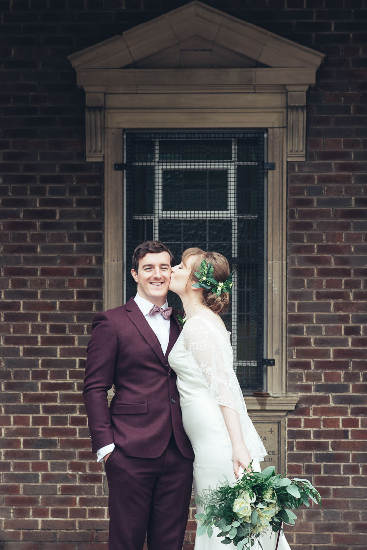 Bride Groom Kiss After Ceremony Romantic Industrial Brick Building Foliage Bouquet | Greenery Burgundy City Autumn Wedding http://lisahowardphotography.co.uk/