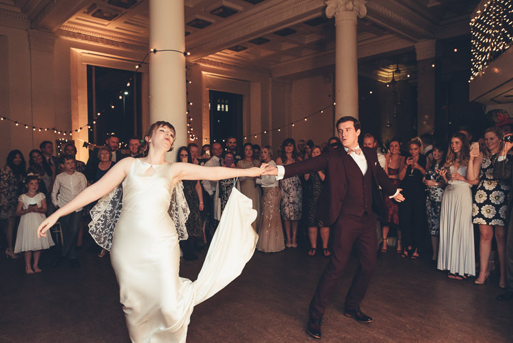Bride Groom Funny First Dance Fast Twirl Fairy Lights Indoor Reception | Greenery Burgundy City Autumn Wedding http://lisahowardphotography.co.uk/