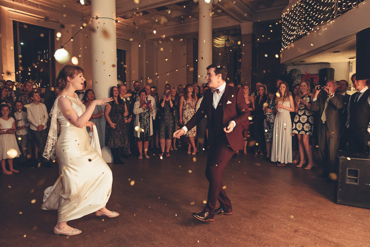 Bride Groom Funny First Dance Fast Twirl Fairy Lights Indoor Reception Confetti | Greenery Burgundy City Autumn Wedding http://lisahowardphotography.co.uk/