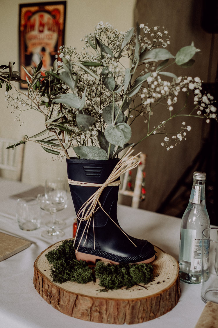 Welly Wellies Flowers Centrepiece Log Stylish Rainy Festival Wedding http://albatrossandmariner.co.uk/