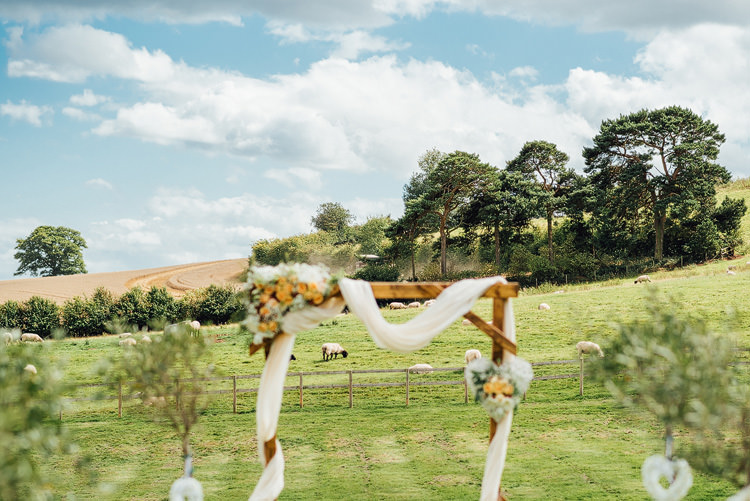 Ceremony Structure Wooden Floral Voile Backdrop Outdoor Summer Rustic Barn Wedding https://www.chebirchhayesphotography.com/