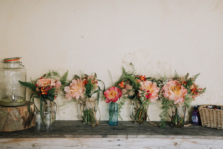 Bottle Flowers Peony Pink Orange Country Barn Wedding http://www.meganduffield.com/
