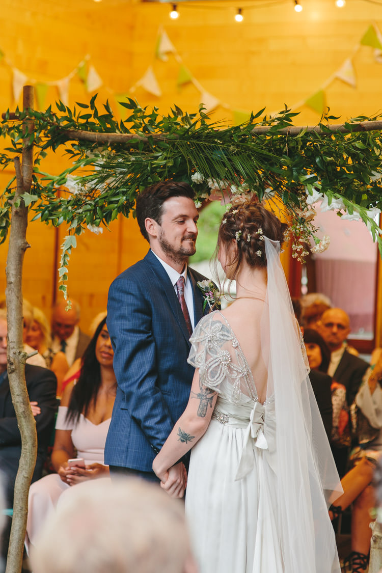 Floral Arch Branch Backdrop Ceremony Happy DIY Woodland Wedding http://www.elliegracephotography.co.uk/