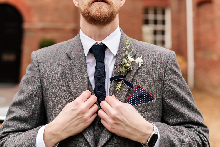 Groom Grey Tweed Suit Buttonhole Tie Magical Fairy Lit Blue Gold Winter Wedding Ideas https://sarahbrookesphotography.com/