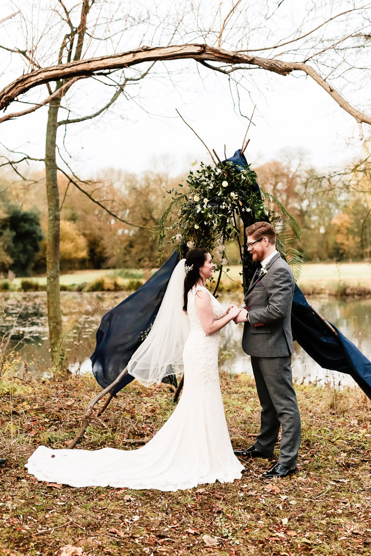 Tipi Backdrop Ceremony Drapes Flowers Magical Fairy Lit Blue Gold Winter Wedding Ideas https://sarahbrookesphotography.com/