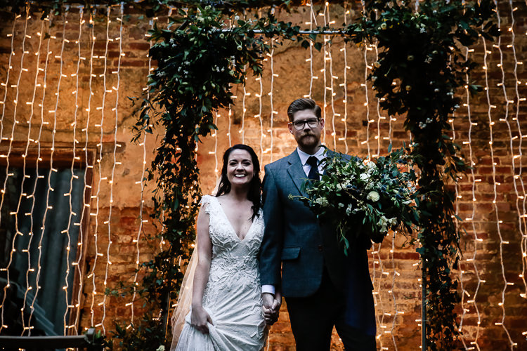 Backdrop Flowers Lighting Decor Arch Arbour Magical Fairy Lit Blue Gold Winter Wedding Ideas https://sarahbrookesphotography.com/