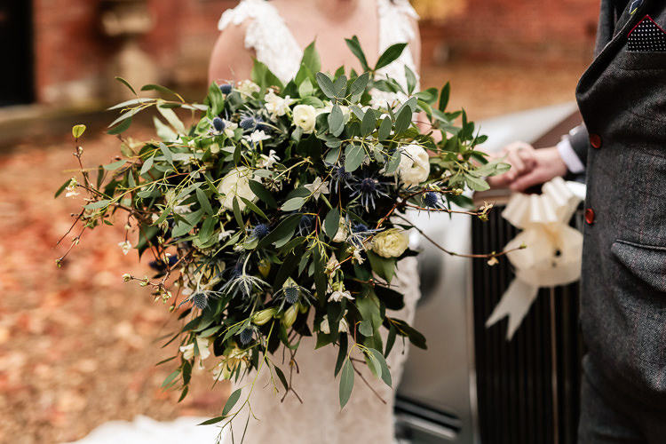 Bouquet Flowers Bride Bridal Greenery Thistle Ranunculus Magical Fairy Lit Blue Gold Winter Wedding Ideas https://sarahbrookesphotography.com/