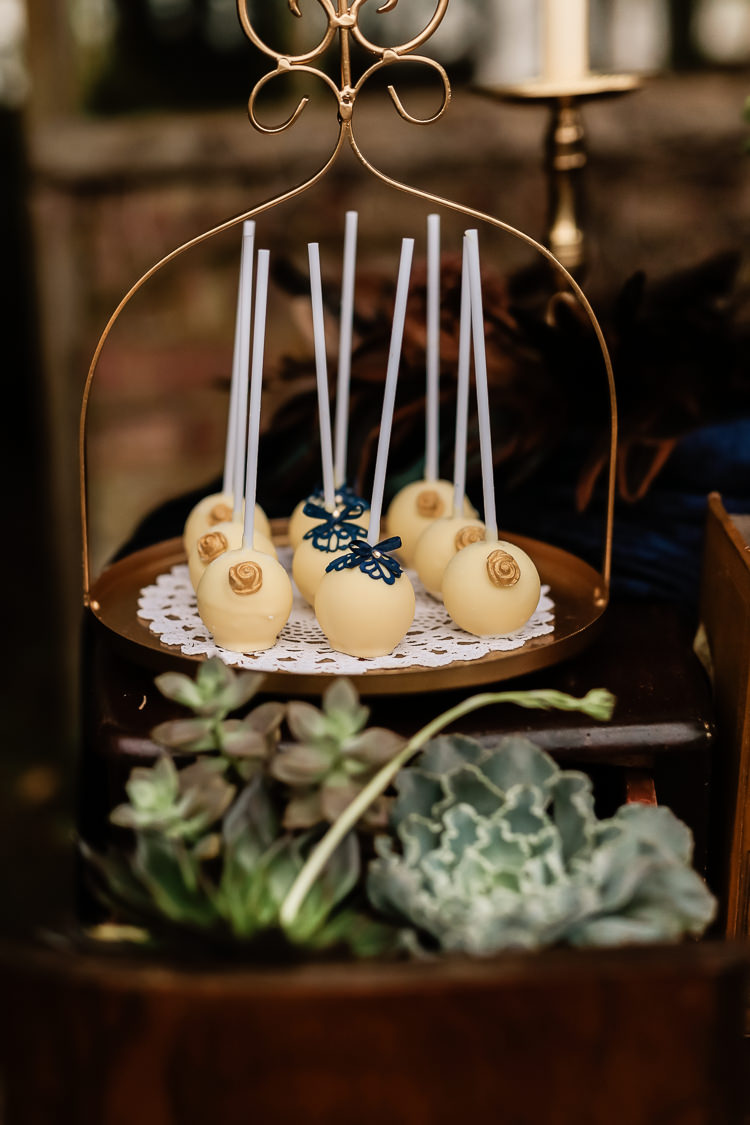 Cake Dessert Table Dresser Furniture Table Pops Magical Fairy Lit Blue Gold Winter Wedding Ideas https://sarahbrookesphotography.com/