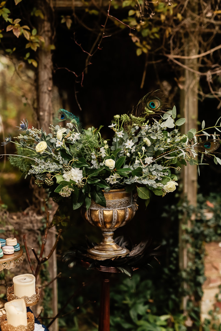 Flowers Peacock Feathers Greenery Thistle Ranunculus Magical Fairy Lit Blue Gold Winter Wedding Ideas https://sarahbrookesphotography.com/