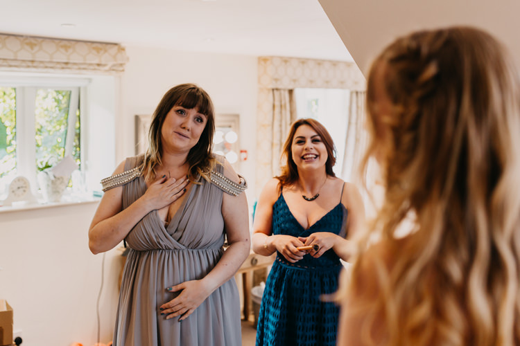 Bridesmaids Bride First Look Emotional Happy Grey Dress | Rustic Relaxed Cornflower Blue Barn Wedding http://www.peterhugophotography.com/