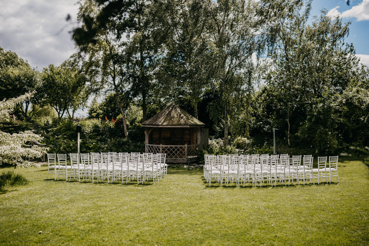 South Farm Cambridgeshire Outdoor Ceremony Aisle Countryside Woodland | Rustic Relaxed Cornflower Blue Barn Wedding http://www.peterhugophotography.com/