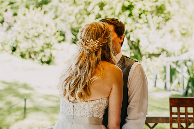 Bride Groom Kiss Braids Long Medium Hair Down Informal | Rustic Relaxed Cornflower Blue Barn Wedding http://www.peterhugophotography.com/
