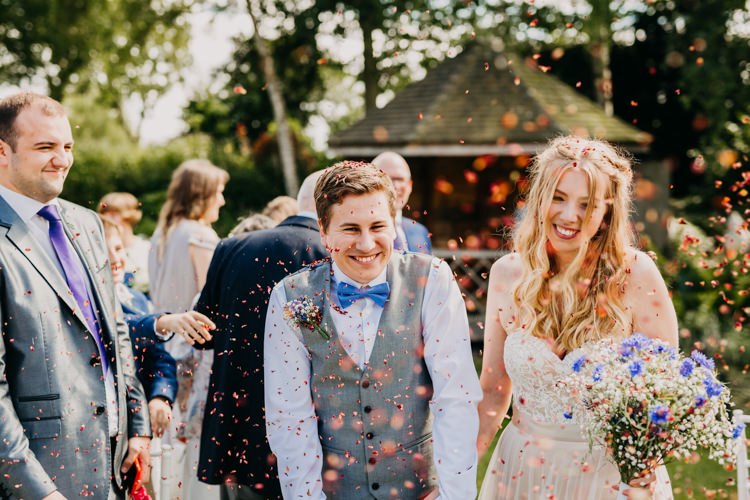 Bride Groom Outdoors Confetti Shot Colorful Petals Informal | Rustic Relaxed Cornflower Blue Barn Wedding http://www.peterhugophotography.com/
