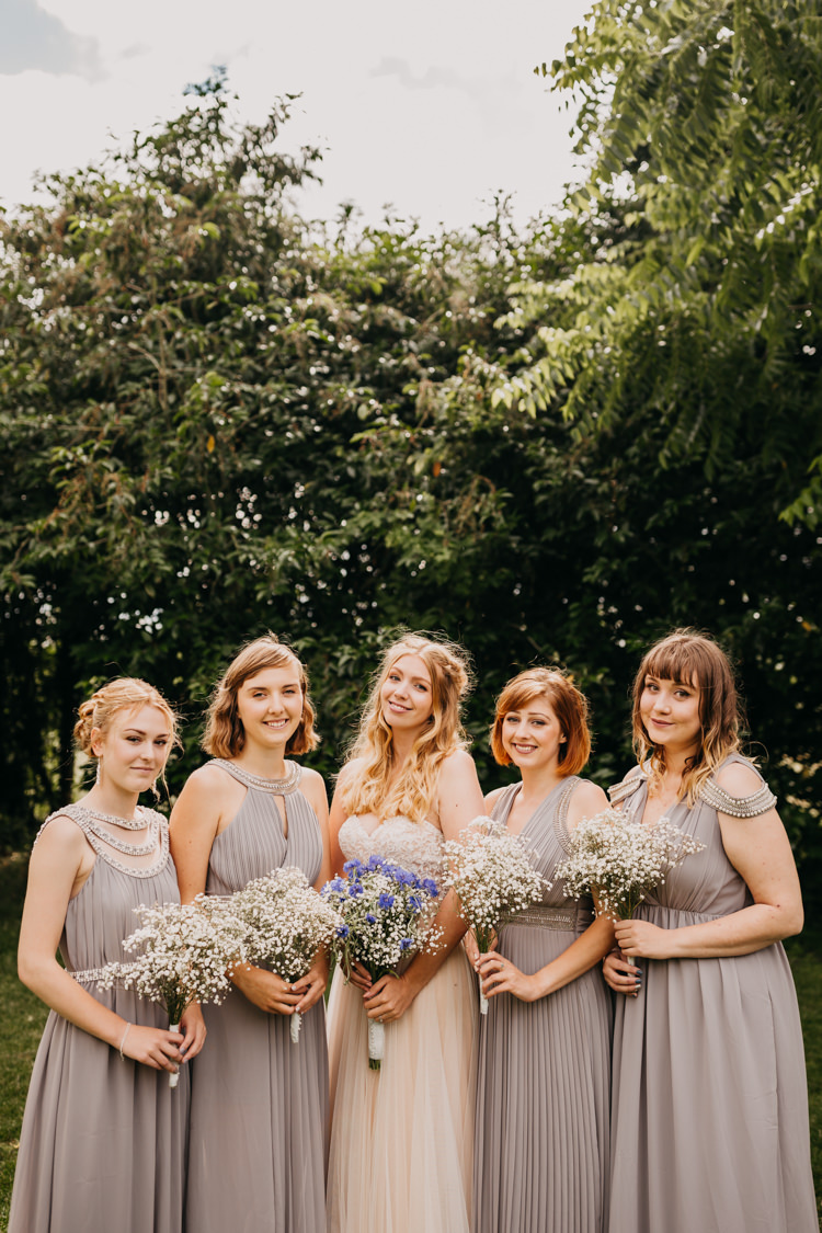 Bride Bridesmaids Outdoor Field Woodland Group Photo | Rustic Relaxed Cornflower Blue Barn Wedding http://www.peterhugophotography.com/