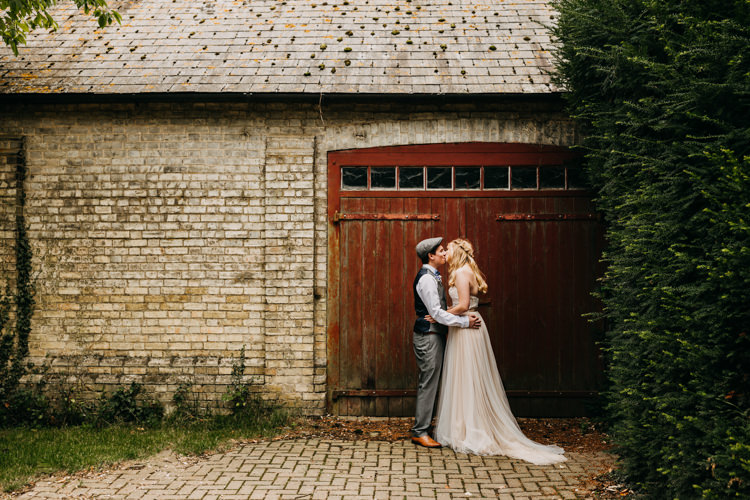 Bride Groom Outdoors Countryside Barn Romantic Kiss Photo | Rustic Relaxed Cornflower Blue Barn Wedding http://www.peterhugophotography.com/