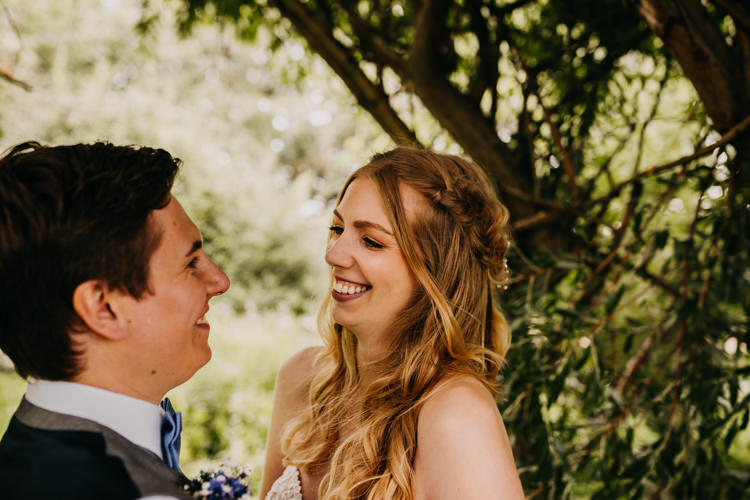 Intimate Bride Groom Outdoors Field Woodland Laughing | Rustic Relaxed Cornflower Blue Barn Wedding http://www.peterhugophotography.com/